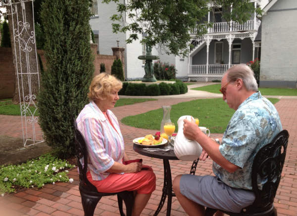 Falcon Manor B&B guests enjoy breakfast in Falcon Rest Mansion's courtyard.