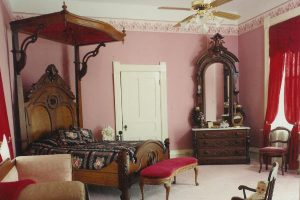 Antique half-tester bed and dresser Victorian antiques at tour mansion in Tennessee
