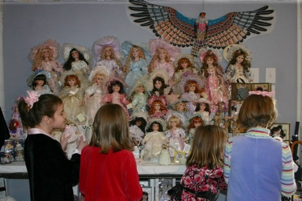 Porcelain dolls -- and living dolls -- in the Victorian Gift Shop at Falcon Rest Mansion