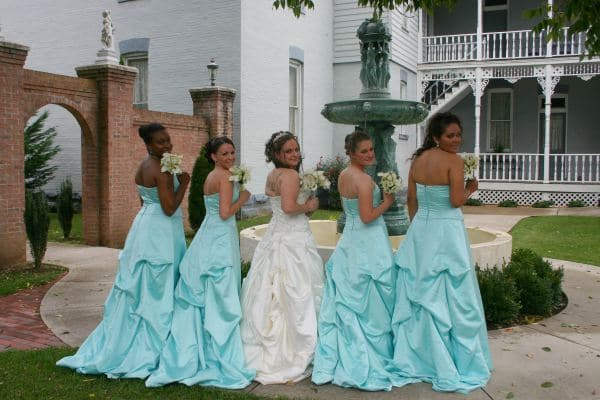 Bridesmaids in courtyard at Falcon Rest Mansion, wedding venue for beautiful photography in Tennessee