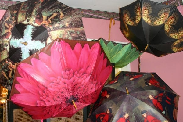 Beautiful umbrellas adorn the ceiling in Falcon Rest's Victorian Gift Shop